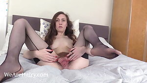 Mercy Quinn poses in black before masturbating