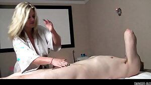 Busty MILF Heather C Payne massaging and blowing a enormous cock